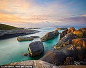 landscapes stock photography | Elephant Rocks, Denmark, South-West Coast, Western Australia, Australia, Image ID AU-WA-ELEPHANT-ROCKS-0002. Elephant Rocks are located 15 kilometres from the town of Denmark in William Bay National Park, south-west WA, about a 4.5-hour drive from Perth. Elephant Rocks and Greens Pool are part of the William Bay National Park known for its rugged coastal scenery. Elephant Rocks are named after the two large elephant-like granite boulders that occupy the upper part of the beach. The steep 60m long beach is located in a 60m wide gap in the bordering granite. At the shore it is fronted by more boulders, which narrow the small bay to about 20 m in width. It widens past the boulders into a protected deep pool in lee of more granite reefs extending 100m seaward, with high wave breaking on the outer rocks. This sheltered beach is absolutely stunning and perfect for family relaxing, swimming and snorkelling.