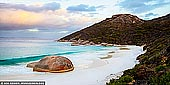 landscapes stock photography | Little Beach and Mt Gardner at Sunset, Two Peoples Bay Nature Reserve, Western Australia (WA), Australia, Image ID AU-WA-LITTLE-BEACH-BEACH-0001. Little Beach is a beautiful and secluded white sandy beach in the Two Peoples Bay Nature Reserve, 35 kilometres east of Albany. It is one of the most beautiful beaches on the south-west coast. Beautiful turquoise waters, white sand and large waves make Little Beach a must-see for travellers to the region. It is a beautiful walk along the beach to where a giant stone stands alone against the sea. The name 'Two Peoples Bay' is from an incident in 1803 when an American whaling ship used the sheltered waters to lay anchor at the same time as a French vessel that was exploring the coastline east of Albany.