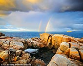 landscapes stock photography | Stormy Sunrise at the Natural Bridge, Torndirrup, Western Australia (WA), Australia, Image ID AU-WA-NATURAL-BRIDGE-0001. A visit to Albany is not complete without seeing the wonder of The Gap and The Natural Bridge, which are part of the amazing Albany's rugged Rainbow Coast. The Natural Bridge is a granite formation that looks just like a giant rock bridge. The natural bridge formation is a reminder of the power of the ocean. When there is a good swell in the ocean, you will see waves burst through under the bridge. Magnificent view of the ocean reaches way beyond the 'natural rock bridge' as you look at the horizon. You can stroll a little further to across the rocky surface and absorb the beauty of the bay and the rough cliffs. During the whale watching season which is from June to October each year when the whales migrate north to deliver their young, they can often be seen playing in the bay.