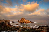 landscapes stock photography | Sugarloaf Rock at Sunrise, Dunsborough, South-West Coast, Western Australia, Australia, Image ID AU-WA-SUGARLOAF-ROCK-0001. On the rugged coast a few kilometres south of Cape Naturaliste in the Margaret River Region, a gigantic granite rock-island looms up out of the ocean. It is called 'Sugarloaf Rock' because it looks like a sugarloaf, which supposedly has a conical/triangular shape like the rock. It is one of the region's most spectacular and photographed coastal landforms and unique environments.