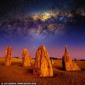 landscapes stock photography | Starry Night in The Pinnacles Desert, Nambung National Park, WA, Australia, Image ID AU-NAMBUNG-PINNACLES-0002. Western Australia has some of the darkest night skies in the world, thanks to its large mass and remoteness to the rest of Australia (and the rest of the world). Plus, being in Earth's southern hemisphere, it shows off one of the best views of the Milky Way Galaxy in the world. In addition, you also get vivid views of the stunning Magellanic Clouds, the Jewel Box cluster of stars and the Southern Cross, which cannot be seen in Europe or America. The Pinnacles are situated in Nambung National Park just 250km north of Perth City. Astro-photography enthusiasts frequent here often to capture interesting images of the Milky Way Galaxy arching above the limestone structures. Under moonlight, the shapes of the pinnacles cast awesome shadows that make for great photos.