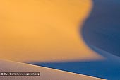 landscapes stock photography | Mesquite Flat Sand Dunes at Sunrise, Death Valley, California, USA, Image ID US-DEATH-VALLEY-0003. Abstract dune pattern in rich yellow by the rising sun at Mesquite Flat Sand Dunes in Death Valley National Park, California, USA.