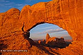 landscapes stock photography | Windows and Turret Arch at Dawn, Arches National Park, Utah, USA, Image ID US-UTAH-ARCHES-NATIONAL-PARK-0007. Turret Arch is beautifully framed by another nearby North Window Arch in Arches National Park in Utah, USA as it was seen early in the morning.
