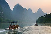 landscapes stock photography | Li River Cruise, Yangshuo, China, Image ID CHINA-YANGSHUO-XINGPING-0006. Cruise the Li River from Guilin to Yangshuo is the highlight of any trip to Guilin and Guangxi province in China. The landscape is decorated with rolling hills, steep cliffs, fantastic caves, leisurely boats and is lined with bamboo. Li River offers stunning views of the karst formations and landscape in the world.