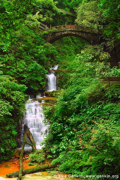 landscapes stock photography | Waterfall and Latent Celestial Bridge, Tianzi Mountain Nature Reserve, Zhangjiajie National Forest Park, China, Image ID CHINA-ZHANGJIAJIE-WULINGYUAN-0001