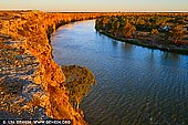 landscapes stock photography | Sunset at Murray River Big Bend, Murray River, South Australia, Australia, Image ID AU-MURRAY-RIVER-0008. Big Bend in South Australia is the longest single bend in the Murray River. The area is known for its spectacular riverside cliffs, which are the tallest along the Murray River. The limestone cliffs are rich with millions of ocean fossils and are home to colonies of bats. Caves in the area have been continuously occupied for at least 8,000 years and are sacred to the local aboriginal community. There is a collection of holiday shacks located on the banks. Big Bend cliffs are located near Nildottie and Swan Reach where you can visit by boat or take a road trip, only one and half hours from Adelaide or 40 minutes from Mannum.