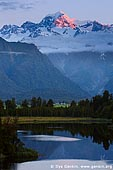 landscapes stock photography   Mt Tasman at Sunset, Lake Matheson, South Westland, South Island, New Zealand, Image ID NZ-LAKE-MATHESON-0004. Sunset over the second highest peak in New Zealand - Mt. Tasman (3,497m) with reflection in beautiful Lake Matheson near Fox Glacier township, situated in Westland National Park on West Coast of the South Island of New Zealand.