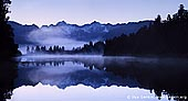 landscapes stock photography | Panorama of Lake Matheson at Sunrise, Lake Matheson, South Westland, South Island, New Zealand, Image ID NZ-LAKE-MATHESON-0006. Panorama of stunning Lake Matheson, also called Mirror Lake, on South Island of New Zealand at Sunrise. The Westland National Park is a beautiful area located on the South Island of New Zealand. This panoramic photo of Lake Matheson was taken with a view of Mt Tasman and Aoraki/Mt Cook reflected in Lake Matheson. The waters of Lake Matheson are dark brown, so on a calm day they create the ideal reflective surface. By a happy coincidence, Mt Tasman and Aoraki/Mt Cook are perfectly positioned to reflect in the lake.