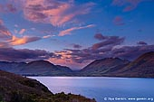 landscapes stock photography | South Part of Thomson Mountains and Lake Wakatipu at Sunrise, Queenstown, Lakes District, Otago, South Island, New Zealand, Image ID NZ-LAKE-WAKATIPU-0002. Great sunrise at Lake Wakatipu from Bennett's Bluff lookout towards south part of Thomson mountains. Lake Wakatipu and the places nearby (Remarkable Mountains, Deer Park, Queenstown and Glenorchy) were the filming locations for many scenes in The Lord of the Rings movie.