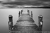 landscapes stock photography | Lake Illawarra Jetty, Lake Illawarra, New South Wales (NSW), Australia, Image ID AU-LAKE-ILLAWARRA-0001. Black and white photo of old jetty at Lake Illawarra in NSW, Australia. Waters at still calm while storm already approaching the lake.