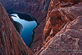 landscapes stock photography   Horseshoe Bend, Page, Arizona, USA, Image ID US-ARIZONA-HORSESHOE-BEND-0003. The view from the rim of Horseshoe Bend of the Colorado River near Page Arizona, USA. It is a very popular spot and is located just outside of Page. This part of the Colorado River is just below Glen Canyon Dam which created Lake Powell and offers easy access to flatwater sections that many people use for recreation year-round. The view of Horseshoe Bend is a popular destination is a 15-minute walk from the parking area to the rim and has fantastic views of the Colorado River.