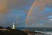 stock photography | Rainbow and The Norah Head Lighthouse at Sunset, Central Coast, Norah Head, NSW, Image ID AULH0024.