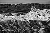 portfolio stock photography | Zabriskie Point, Death Valley, California, USA, Image ID AMERICAN-SOUTHWEST-BW-0002. Sunrise creates an interesting play of light and shadow on the badlands at Zabriskie Point in Death Valley National Park, California, USA.