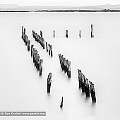 portfolio stock photography | West Jetty at Tenby Point, Western Port Bay, Victoria (VIC), Australia, Image ID AUSTRALIAN-COAST-BW-0005. Beautiful black and white photo of the West Jetty with long exposure at high tide from the picturesque shores of Tenby Point on Western Port Bay, Victoria, Australia.
