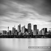 portfolio stock photography | The Sydney City Skyline, Sydney, NSW, Australia, Image ID SYDNEY-IN-SQUARE-0001. Magnificent black and white photo of the Sydney city skyline from the walking path along the shore of Sydney harbour near Mrs Macquarie's Chair in Sydney, NSW, Australia.