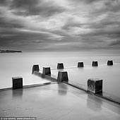 portfolio stock photography | Coogee Beach, Sydney, NSW, Australia, Image ID SYDNEY-IN-SQUARE-0007. Fine art black and white minimalist photography of the tidal pool at the Coogee Beach in Sydney, NSW, Australia with dramatic clouds.