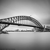 portfolio stock photography | Sydney Opera House and Harbour Bridge, Milsons Point, Sydney, NSW, Australia, Image ID SYDNEY-IN-SQUARE-0009. Black and white fine art photo of the Sydney Opera House and the Harbour Bridge with the Sydney City in a background early in the morning as it was seen from Luna Park in Milsons Point, NSW, Australia.
