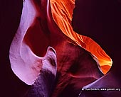 portfolio stock photography | Colorful Lower Antelope Canyon, Navajo Tribal Park, Page, Arizona, USA, Image ID AMERICAN-SOUTHWEST-0001. Antelope Canyon is the most-visited slot canyon in the American Southwest. It is located on Navajo land near Page, Arizona. Antelope Canyon includes two separate slot canyon sections, Upper Antelope Canyon or and Lower Antelope Canyon. Both Canyons were formed by erosion of Navajo Sandstone, primarily due to flash flooding and secondarily due to other sub-aerial processes. Rainwater, especially during monsoon season, runs into the extensive basin above the slot canyon sections, picking up speed and sand as it rushes into the narrow passageways. Over time the passageways are eroded away, making the corridors deeper and smoothing hard edges in such a way as to form characteristic 'flowing' shapes in the rock.