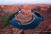 portfolio stock photography | Horseshoe Bend at Twilight, Page, Arizona, USA, Image ID AMERICAN-SOUTHWEST-0006. The most classical picture or a cliche photo of the Horseshoe Bend south of Page in Arizona, USA where the Colorado River makes a dramatic, almost circular bend. The towering red cliffs are about 1,000 feet (305 meters) above the river.