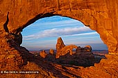 portfolio stock photography | Sunrise at Windows and Turret Arch, Arches National Park, Utah, USA, Image ID AMERICAN-SOUTHWEST-0007. The region called 'The Windows' in Arches National Park, Utah, USA contains magnificent formations like on this stock photo of the Turret Arch through North Window Arch at sunrise.