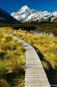 portfolio stock photography | Walking Path to Hooker Lake and Aoraki/Mount Cook, Mackenzie Region, Southern Alps, South Island, New Zealand, Image ID NEW-ZEALAND-0006. Stock image of the where Aoraki/Mount Cook and boardwalk in the Hooker Valley leads to the Hooker Glacier and the Hooker Lake in the Aoraki Mt Cook National Park, Southern Alps, South Island, New Zealand.