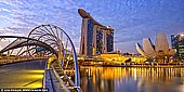 singapore stock photography | Marina Bay Sands Hotel and Helix Bridge at Sunrise, Marina Bay, Singapore, Image ID SINGAPORE-0006. The Helix Bridge, previously known as the Double Helix Bridge, is a pedestrian bridge linking Marina Centre with Marina South in the Marina Bay area in Singapore. The Helix Bridge is set to become Singapore's next landmark. Located beside the Benjamin Sheares Bridge, alongside the vehicular Bayfront Bridge, it was officially opened on 24 April 2010 and is the world's first curved bridge. The views of the harbor and some of the city's great buildings are wonderful. A night visit is preferable to see the lights and the magnificent view.