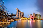 stock photography | Marina Bay Sands Hotel at Sunset, Marina Bay, Singapore, Image ID SINGAPORE-0001. Night view of the Helix Bridge, Marina Bay Sands Hotel with its spectacular rooftop infinity pool and ArtScience Museum in Singapore.