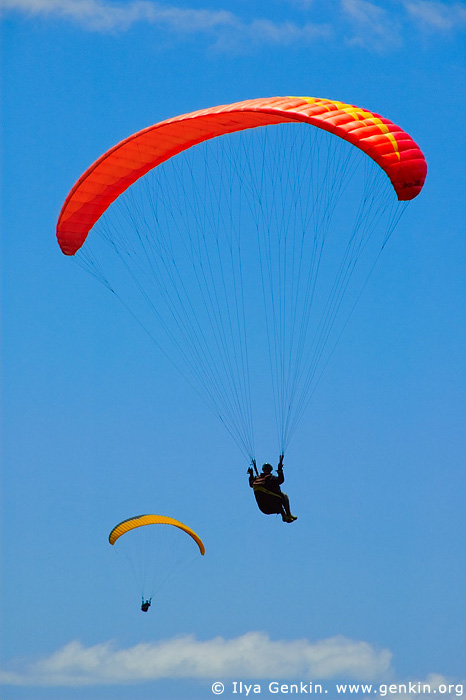 Above the Clouds. Paragliders Soaring in the Blue Sky.