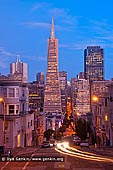 usa stock photography | Transamerica Pyramid at Dusk, San Francisco, California, USA, Image ID US-SAN-FRANCISCO-0001. The Transamerica Pyramid is the most recognisable and the tallest skyscraper in the San Francisco skyline. Although the building no longer is the head office of the Transamerica Corporation, it is still strongly associated with the company. Designed by architect William Pereira and built by Hathaway Dinwiddie Construction Company, at 260 m (850 ft), upon completion in 1972 it was among the five tallest buildings in the world.