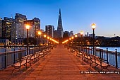 usa stock photography | Pier 7 and Transamerica Pyramid in the Evening, San Francisco, California, USA, Image ID US-SAN-FRANCISCO-0002. Pier 7 and the Transamerica Pyramid building during nightfall in San Francisco, California, USA. Pier 7 provides some of the best views of San Francisco's skyline. From the pier you can see Coit Tower, the Transamerica Pyramid, skyscrapers in the financial district, and the Oakland Bay Bridge. The pier was originally built in 1901, but it was damaged in the 1989 Loma Prieta Earthquake and subsequently was demolished and rebuilt. The pier is 840 feet long and extends into water 35 feet deep.