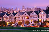 usa stock photography | The Painted Ladies at Dusk, Alamo Square, San Francisco, California, USA, Image ID US-SAN-FRANCISCO-PAINTED-LADIES-0001. The 'Seven Sisters of Postcard Row', also known as the 'Painted Ladies', Victorian style houses at Alamo Square in Haight-Ashbury District, San Francisco, CA, USA with the city skyline in the background on a colourful pink sunset. This row has become (along with the Golden Gate Bridge and Alcatraz) synonymous with San Francisco.