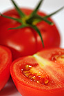 Whole and cuted tomatoes. White background. Isolated.
