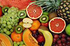 Set of different fresh fruits. Colorful background.